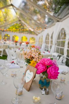 natural yet bright wedding reception table decor http://www.weddingchicks.com/2014/03/03/lake-tahoe-estate-wedding-with-coral-and-teal-colors/