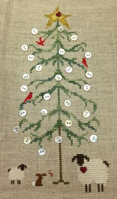 This is the Button Tree from Drawn Thread stitched by Gladys R. She added sheep and bunny. Suwannee Valley Cross Stitch shop in Trenton, Fl.  sallyxstitch@mindspring.com