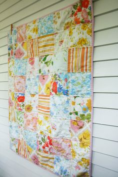 I finally made a baby quilt using some of my vintage sheets! I actually made two, but the other didn't photograph so well, so you'll have to...