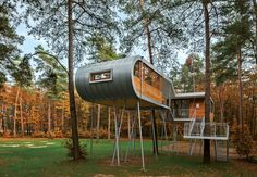 To reduce impact at this forested site, Baumraum prefabricated a treehouse and craned it atop 19 steel columns, arranging it so that the surrounding trees' roots wouldn't be harmed.