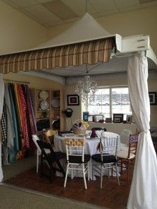 Victorian frame tent for rental on display in our showroom.