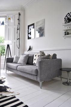 modern mid-century living space, cowhide rug, scandinavian design--repin via J'ena SanCartier