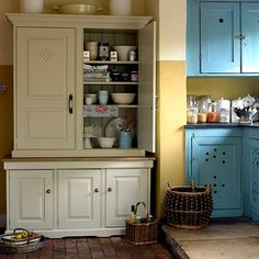 Painted larder cupboard in this country kitchen.