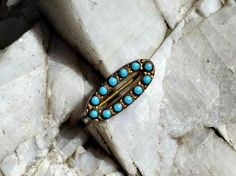 Tiny Turquoise and Gilt Finish Brooch or Pin, Victorian Era Oval with Bezel Set 2mm Cabochons, Simple C Clasp, Unsigned by postGingerbread on Etsy