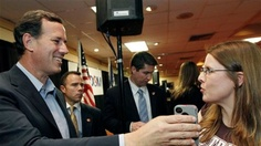 9. Published March 24, 2012FoxNews.com    Rick Santorum, takes the phone from Allison Patterson to speak to her husband, a supporter who could not make the rally in Shreveport, La., Friday, March 23, 2012. (AP)