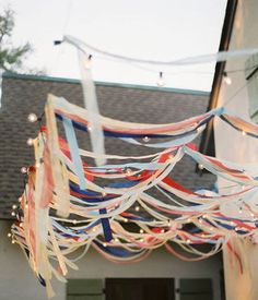 Outdoor decorating for a Fourth of July Party: Streamers over Cafe Lights! Streamer Party Decorations, 4th Of July Decorations, Party Streamers, Outdoor Decorations, Hanging Decorations, Wedding Decorations, Bbq Party, Fiesta Party, Soirée Bbq