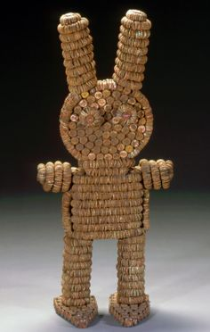 Clarence Woolsey (American, 1929-1987) Grace Woolsey American, d. 1988 Bottlecap Figure, 1970 Bottle caps, nails and wood 43 x 20 x 12 in. (109.22 x 50.8 x 30.48 cm) Milwaukee Art Museum, Gift of Friends of Art and Ruth and Robert Vogele M1998.95 Photo credit Larry Sanders