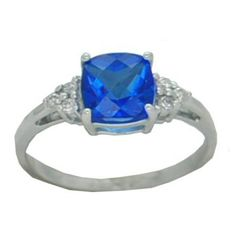 Blue Topaz Ring with 0.07 cttw. Diamonds https://www.goldinart.com/shop/rings/colored-gemstone-rings/blue-topaz-ring-with-0-07-cttw-diamonds