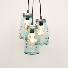 ThisMason Jar Chandelier features 3 vintage quart-sized mason jars and is the perfect way to light up your space in a stylish and affordable way. Each light has 10 feet of black or white cord wit… Mason Jar Light Fixture, Mason Jar Chandelier, Rustic Chandelier, Mason Jar Lighting, Chandeliers, Light Fixtures, Chandelier Lighting, Quart Size Mason Jars, Quart Jar