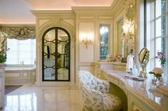 The shower door, positioned between the tub and vanity, is actually constructed of twoway mirrored panels  Light streams in through the windows, which can be concealed with mirrored shutters that slide from within the walls  Bath  TraditionalNeoclassical by Sherry Hayslip Interiors & Hayslip Design Associates, Inc