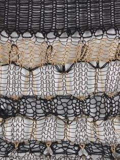 Juliana Sissons/Black and gold knitted sample with stripes, tuck stitch, transfer stitch and tension variation
