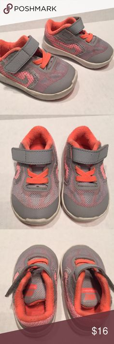 Nike Revolution 3 shoes Nike Revolution 3 shoes. 3C. Velcro closure. Gray and coral. Some wear. Stains on white rubber Nike Shoes Sneakers