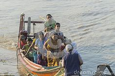 Port in Yangun, Myanmar . People are coming out of the boat. Port in Yangun.  http://en.wikipedia.org/wiki/Yangon http://www.mot.gov.mm/mpa/ygn_ports.html