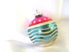 Sweet vintage Shiny Brite Christmas ornament has a hot pink top with mica polka…