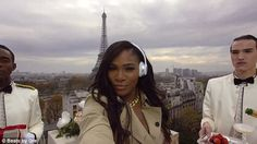 Ooh la la! Tennis pro Serena Williams looked trés chic on a Paris rooftop with two manserv...