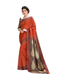 Rusty Red Silk Printed Saree Description: The Rusty Red Silk Printed Saree brings traditional vibe at its best. The delicate designer saree comes in an unusual shade of rusty red, which is matched with a silk blouse in brown. Flaunt your best traditional jewelry with the saree to make a complete ensemble.  Details: Printed Work  Sizes Available: Saree Length- 5.5 meter Blouse Piece  Size upto 42 inches Blouse Piece Length- 0.80 meter  Colour and Fabric: Saree- Rusty Red, Blouse- Bro