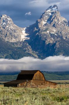 """If this idyllic farm scene feels familiar to you, there's a good reason. Say hello to Grand Teton National Park's famous T. Moulton Barn, also known as """"the most photographed barn in America. Badlands National Park, Grand Teton National Park, Yellowstone National Park, National Parks, Wyoming Vacation, Vacation Trips, Tennessee Vacation, Vacation Outfits, Vacation Spots"""