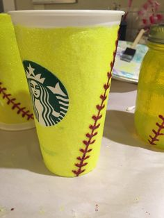 Take $1 Starbucks cup, use Dishwasher safe Mod Podge and glitter and...Boom!  Personalized, Blinged out softball cups.  WARNING: Mod Podge states it takes 28 days to cure - plan ahead.