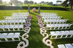 gorgeous pink to purple ombre petal aisle decor