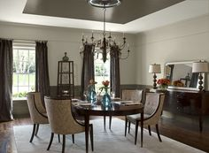 A dark ceiling adds dimension to this distinctive dining room.  Ben Moore Stone hearth walls, north creek brown ceiling accent, wainscoting, dune white ceiling