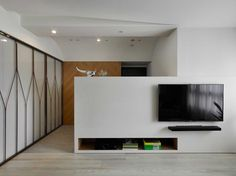 Jiang Residence is a minimalist interior located in Taipei, Taiwan, designed by KC design studio. Arch Interior, Interior Architecture, Interior Design, Living Room Tv Unit, Living Room Interior, Living Rooms, Taipei, Tv Console Design, House Cladding