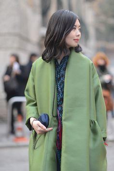 Nancy Zhang in Alberta Ferretti Coat.