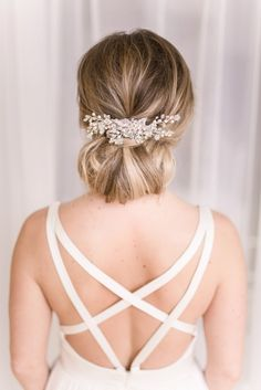Elegant up-do with crystal hairpiece | See more http://www.adornmagazine.com/blog