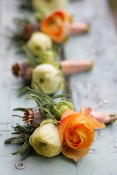 Orange ranunculus, and other textural elements.