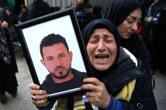 A relative of someone killed in the Nov. 12 attack on Beirut, holds up his picture, as she grieves - Google Search
