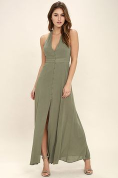 We can't get the Lingering Thoughts Olive Green Halter Maxi Dress off our minds...not that we mind! Light and gauzy woven rayon shapes a plunging neckline and princess seamed, halter bodice. A covered button placket leads to a banded waist and maxi skirt with center slit. T-strap back.