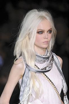 Intense blonde, it's like albino chic. I don't think I can pull it off but she's beautiful.