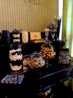 1920's Black, White & Gold Candy / Lolly Bar - Cigar boxes with choc licorice logs tied with gold ribbon to look like cigars, FADs with edible glitter on end to look like cigerettes, glitter paper to cover small rounds of lollies.