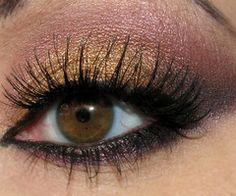 Eyes - For my lil' sister, she does this beautifully!  Gold on the lid, plum in the crease, darker purple on the outter corner and under the eyeliner.