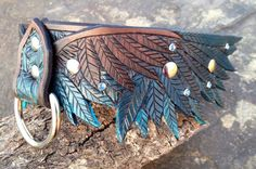 Hey, I found this really awesome Etsy listing at https://www.etsy.com/listing/203205378/wing-hand-tooled-leather-dog-collar-teal
