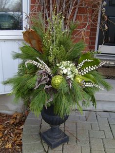 christmas urns outdoors outdoor planters how to make Christmas Urns, Outdoor Christmas Decorations, Christmas Holidays, Christmas Wreaths, Christmas Crafts, Holiday Decor, Christmas Urn Fillers, Christmas Ideas, Winter Planter
