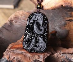 Obsidian Koi Carp Necklace, handcrafted and available at https://takumiarts.com  Fine Japanese Jewelry from myths and legends : Dragon, Phoenix, Maneki Neko, Koi Carp, Sakura flowers, Youkai and much more.  Handcrafted from sterling silver, pure silver and 18k gold.  Free shipping and worry-free returns.