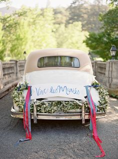 Hand signed getaway cars with just a little greenery and ribbon makes all the difference!!!  Getaway car decoration