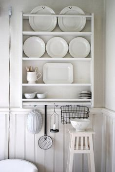 Love this white kitchen storage. Notice hanging just under the lowest shelf, there are copper molds and other pieces which have all been painted white too! Kitchen Display, Kitchen Storage, Kitchen Decor, Kitchen Dresser, Wall Storage, Plate Racks, Plate Shelves, Plate Wall, White Dishes