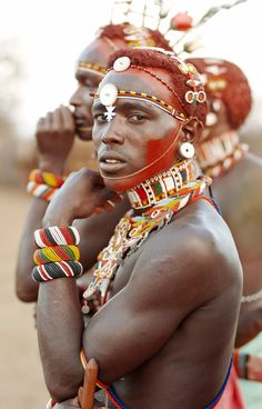 To generalise a moran's fashion you have a kikoy, a Kenyan sarong that is the main clothing, a beaded belt that will hold a long knife, and strings of beads that will crisscross his chest (an important sign of being a moran). He will wear numerous beaded bracelets on his wrists, on his elbow a beaded leather strap (another important mark of a moran). Notched body markings will be made with thorns and a knife | SamburuTrust.org  #world_cultures