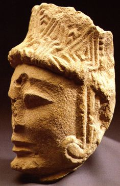 La Dama de Elche. This fragmentary head from El Corral de Saus shows a different kind of headdress, beautifully patterned, with long pendants beside the ears.