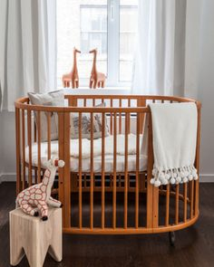 Stokke Sleepi Crib - can be converted to toddler bed with kit. Rounded crib bedding would be so hard to find but they're so cute!