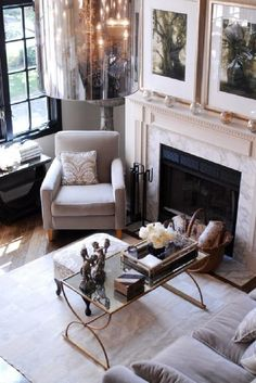 love the coffee table Suzie: Colette May   Gorgeous sunny gray living space design with ivory fireplace with marble ...