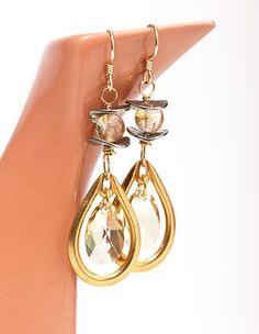 "Golden Opulence Earrings featuring TierraCast Wavy Disk spacers and 1 3/16"" Teardrop pendants. Design by Denise Varville for TierraCast. Teapot spout..."