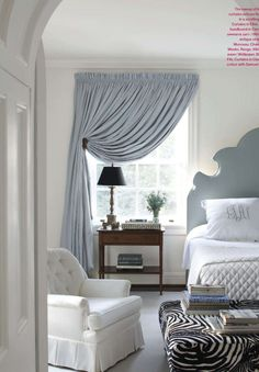 White walls, colorful Headboard and curtains