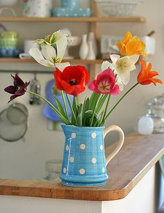 Spotted jug and beautiful flowers.