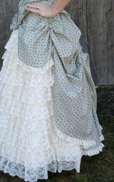 I love this bustle but I'm also loving this dress