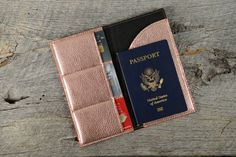 This rose gold leather wallet will be your favorite travel partner! Handcrafted with luxurious metallic leather, this multi-function wallet includes pockets for 3 credit cards, bills, and a space for your boarding pass and passport. Make it yours with an elegant initial stamped on the front! Comes in a gift box, ready to present. Measures 7 1/4 x 4 closed, 7 1/4 x 8 open.  View our entire rose gold collection here: http://etsy.me/2lFoPAh  Our leather products are enti...