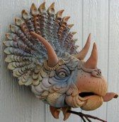 Kooky, crazy, original and awesomely artistic bird houses! Love it! Triceratops dinosaur