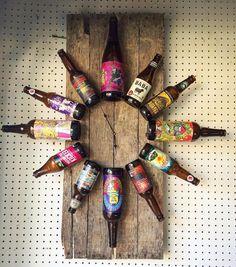 Beer o'clock! Repurposed beer bottles on reclaimed wood