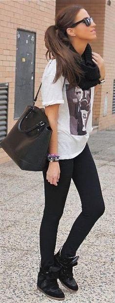 Street fashion with black leggings, t-shirt and handbag -